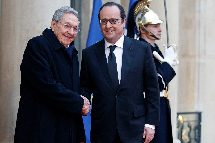 French President Francois Hollande welcomes Cuban President Raul Castro (left) at the Elysee Presidential Palace in Paris, France on February 01, 2016.