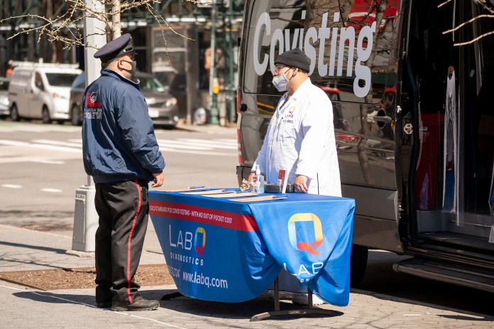 A person visits a LabQ Diagnostics COVID-19 PCR testing van on the Upper West Side on March 30, 2021.