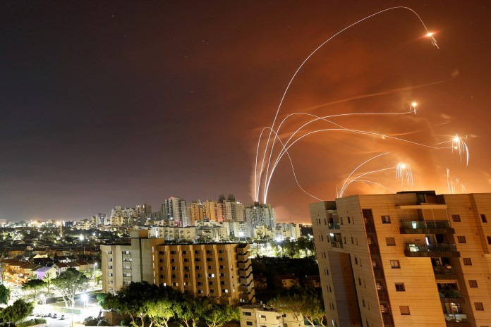 Streaks of light are seen as Israel's Iron Dome anti-missile system intercept rockets launched from the Gaza Strip towards Israel.