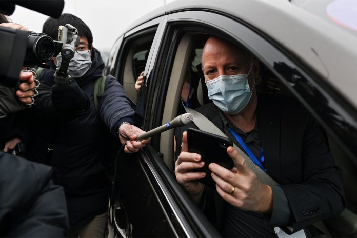 Peter Daszak speaks to media upon arriving with other WHO members to the Wuhan Institute of Virology.