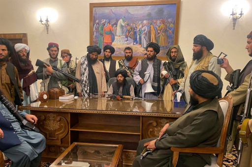 Taliban fighters inside of the presidential palace in Kabul, Afghanistan after Ghani fled the country on August 15, 2021.