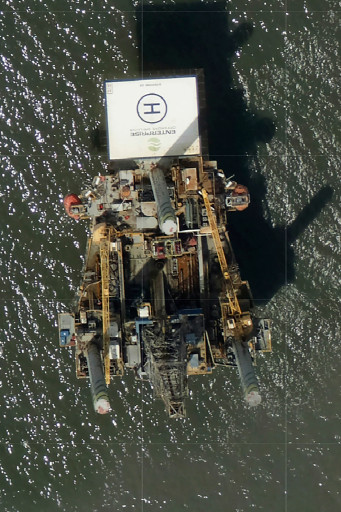 a large rig marked with the name Enterprise Offshore Drilling is seen.