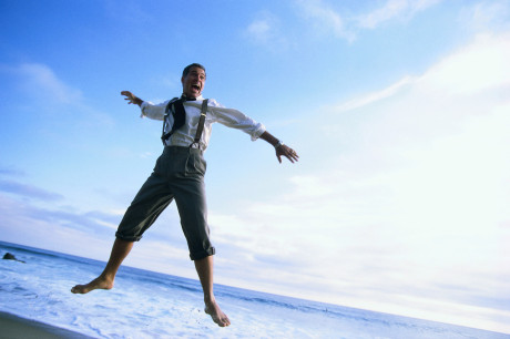 Businessman Jumping at Beach