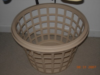 Empty_laundry_basket_in_closet
