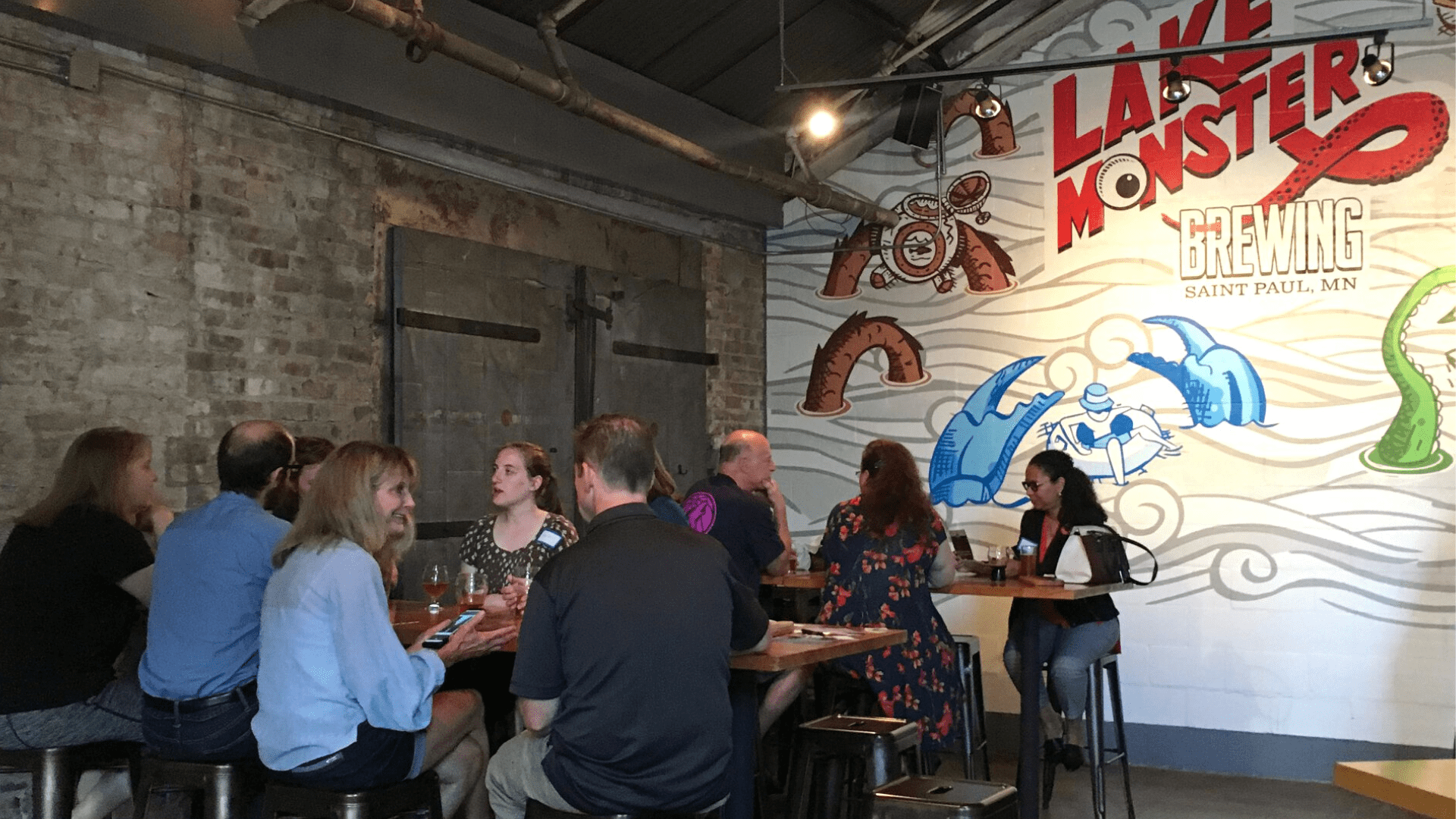 Happy hour attendees at Lake Monster Brewing