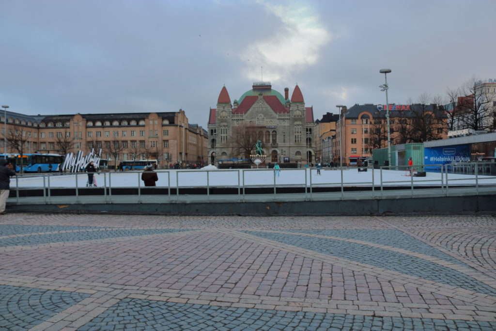 A skating rink in the train station plaza of Helsinki
