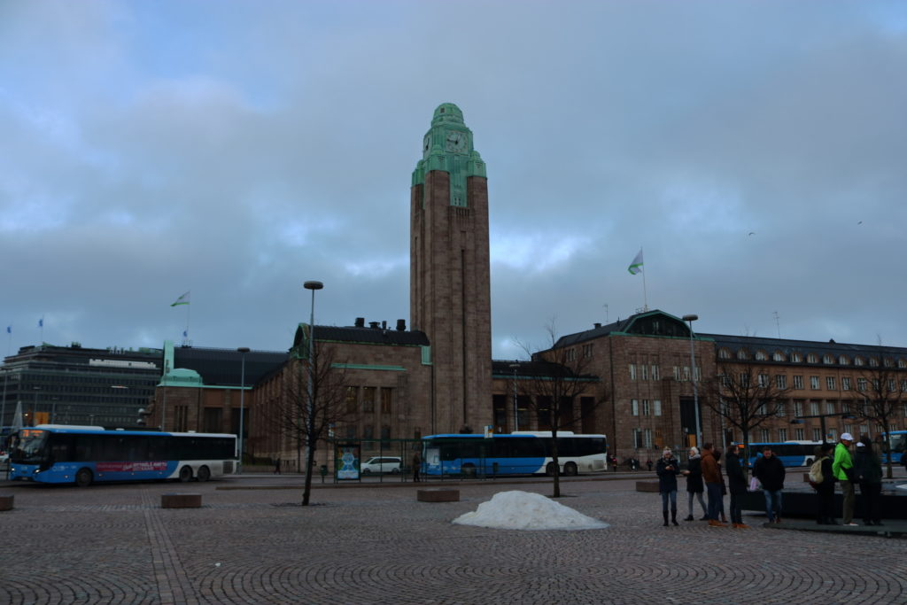 In focus there is the clock tower of the Helsinki train station.