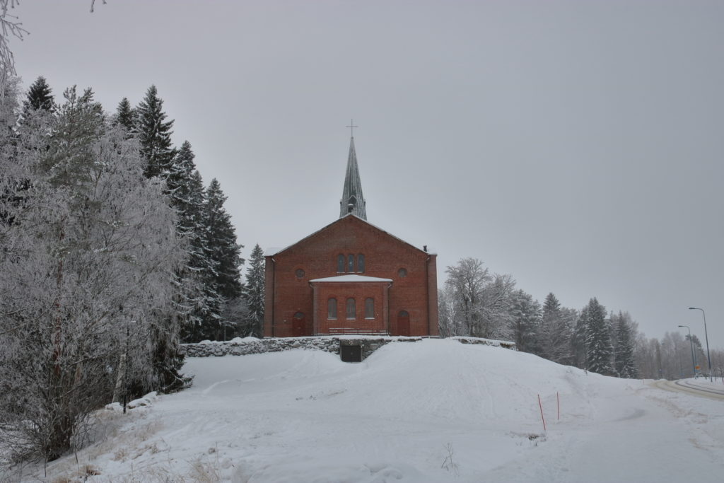 A distant picture of the Liperi Church's back