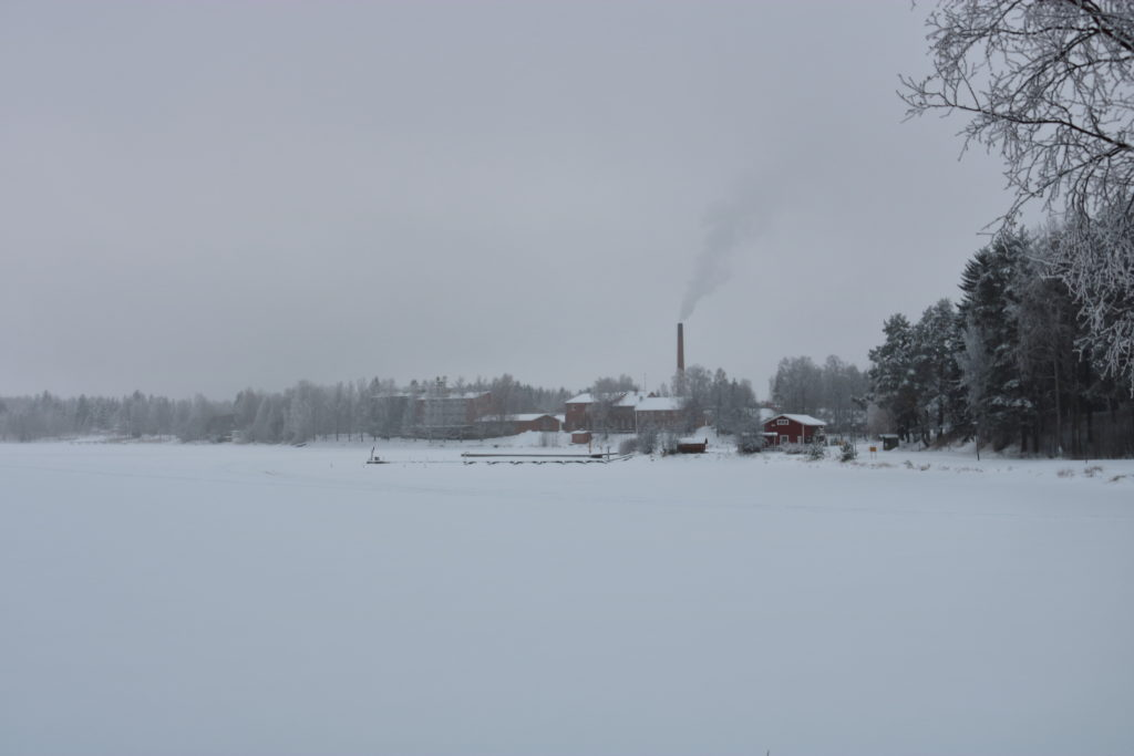 A distant factory building