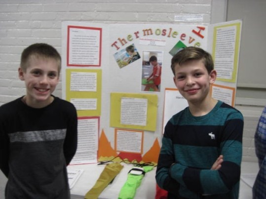 Jackson Miller and Owen McDonald, sixth grade students at the Dr. John C. Page Elementary School in West Newbury, received two awards for their Thermosleeve invention this May. (Courtesy Photo Pentucket Regional School District)