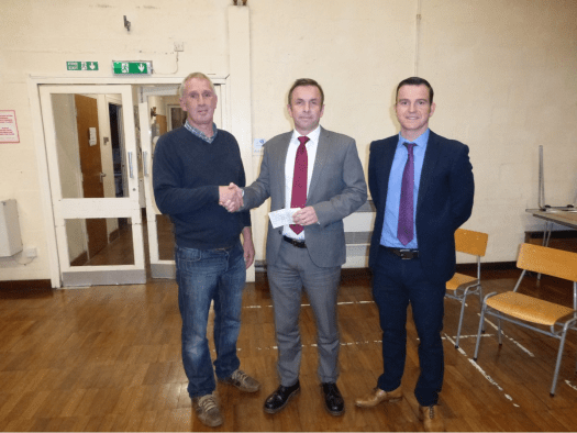 Huw Morris presenting a cheque to Llanfyllin high school