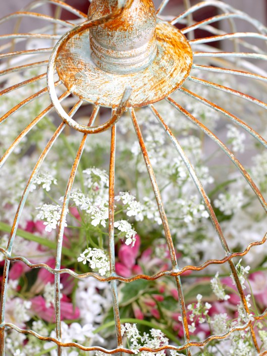 Flowers In A Birdcage