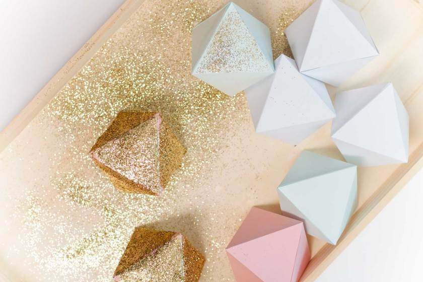 Treat your inner math nerd to some craft time. This DIY Glitter Octahedron Garland is quick and easy to make while also adding some sparkle to your walls.