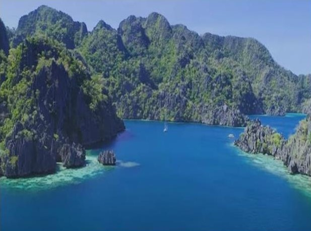 Coron Rock Formation and Blue Water