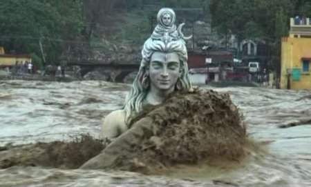 A huge statue of the god Shiva being washed away during the floods in Uttarakhand in 2013