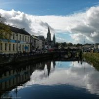 south channel of the River Lee in Cork city on a sunny day, looking towards Saint Fin Barre's Cathedral