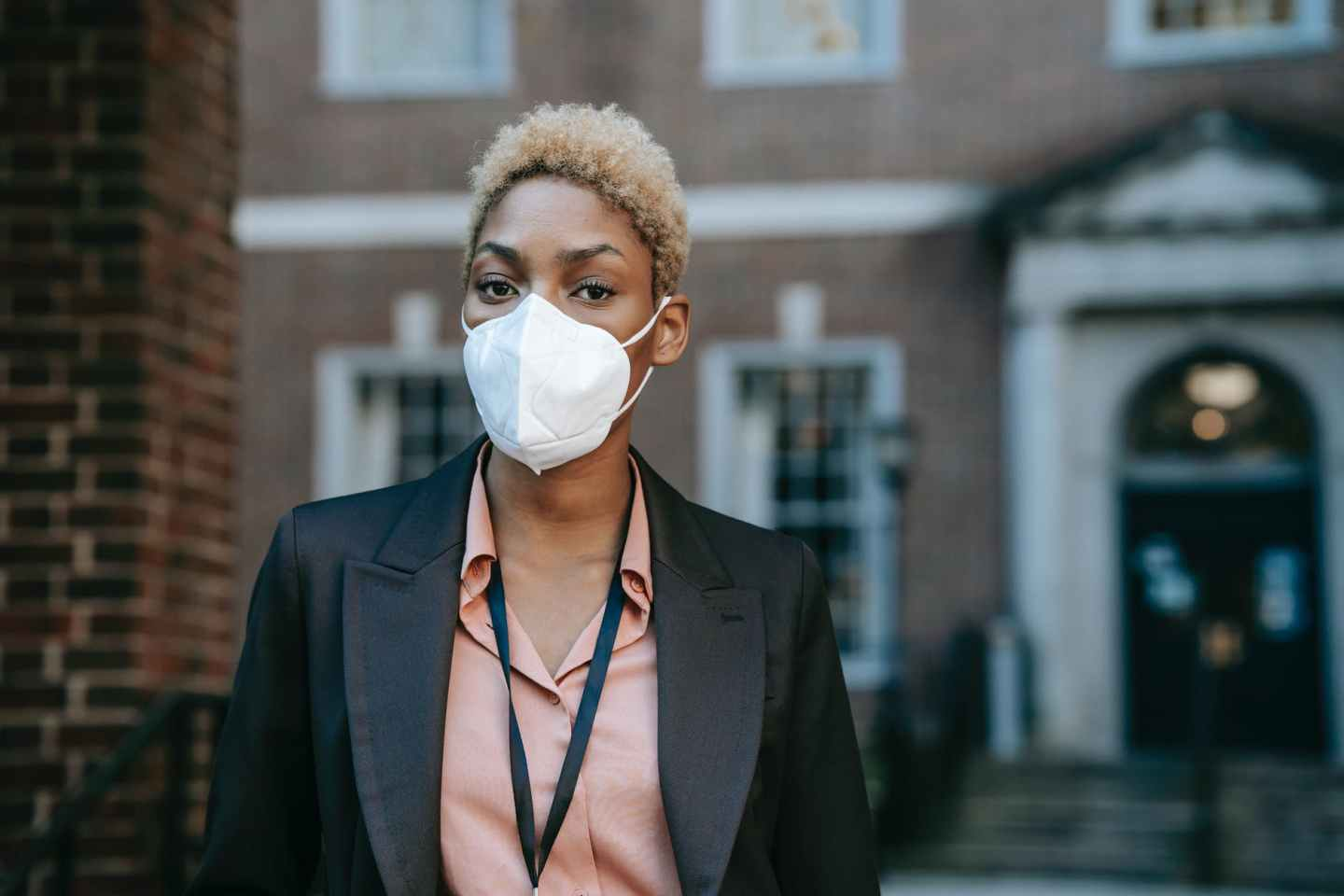 ethnic businesswoman in protective mask