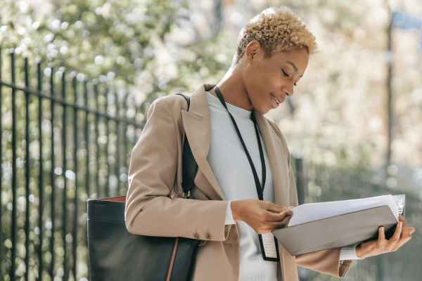 content ethnic businesswoman looking through papers