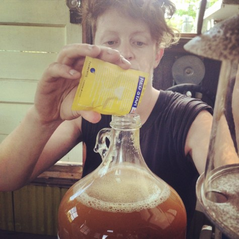 Kai making apple hooch aboard the shantyboat