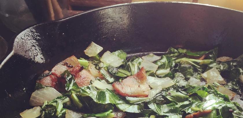 Collard greens and jawbone bacon for breakfast. Next up buttery grits and hush puppies