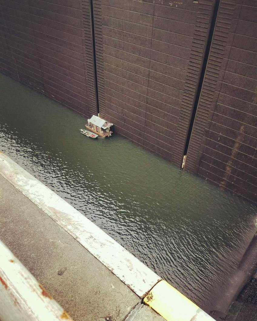 Tiny tiny shantyboat 93 feet down at the bottom of Wilson Lock and Dam. Thanks to Gino, one of the lock staff, for the photo