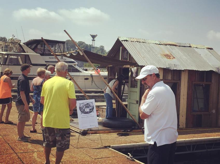 Visitors at the shantyboat open house
