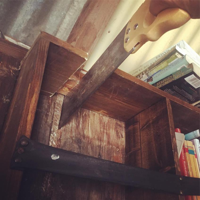 Weird things afoot – cutting into the shelves for a crossbeam to support the extended loft