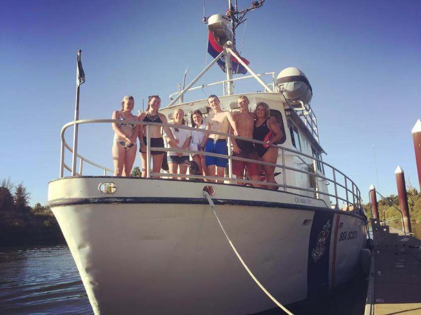 The mostly girl crew of the Sea Scout vessel Compass Rose who gave us a tour of the 60+ foot formal Naval ship