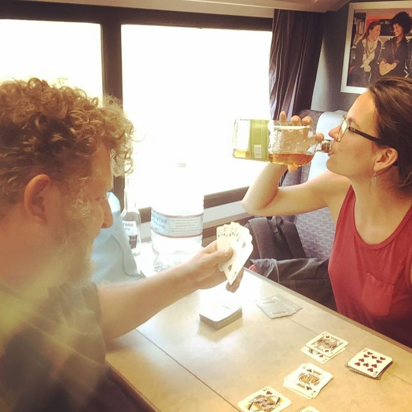 Playing cards on the Davis to Sacramento train. We had to drive from Sac to Davis to catch an unnecessary train because Amtrak wouldn't sell us a bus ticket from Sac to Red Bluff without a train segment on our ticket. It was still cheaper and faster than Greyhound