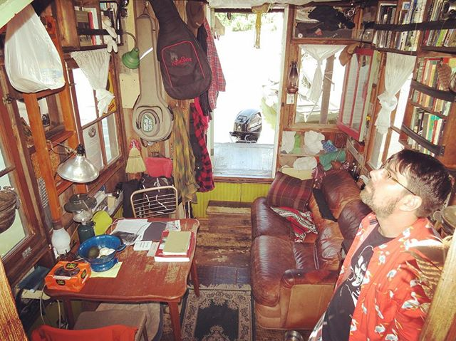 Jeremiah and the ordered chaos of the shantyboat mid-journey. Photo by Paul Abitabile