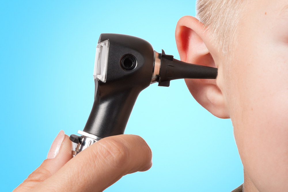 doctor checking ear