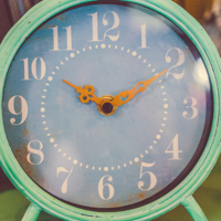 Photo of antique green alarm clock to show why planning how you spend your time is key to a healthy lifestyle
