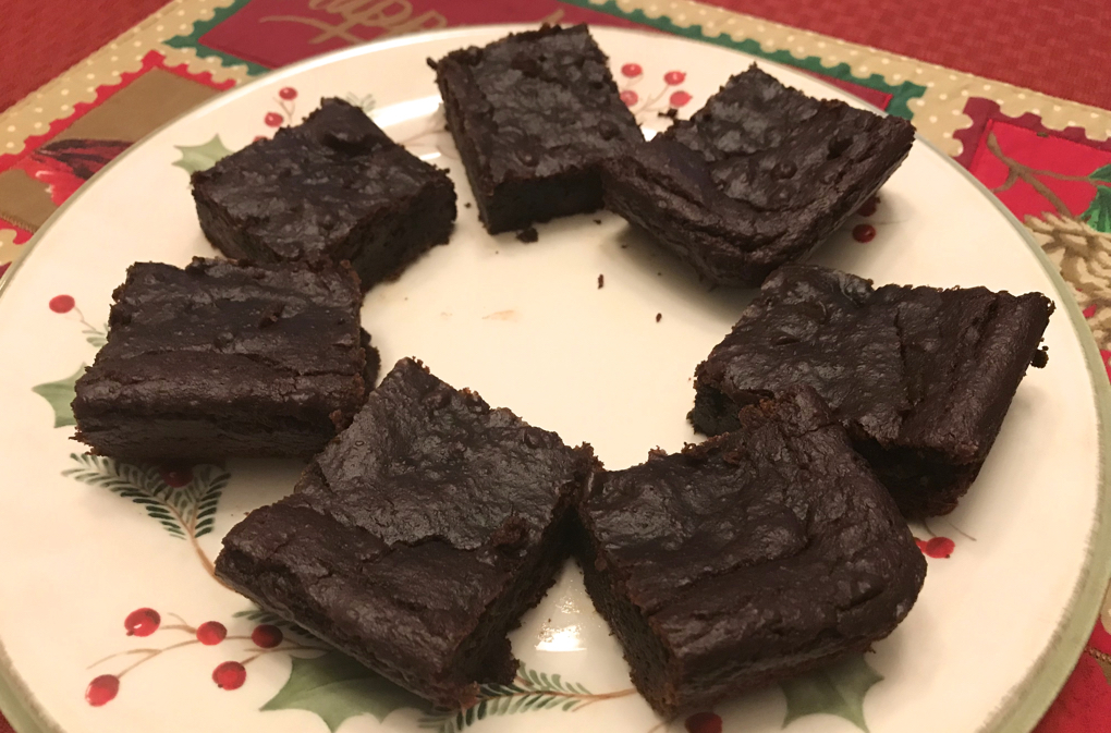 Photo of Paleo Chocolate Gingerbread Bars on holiday plate