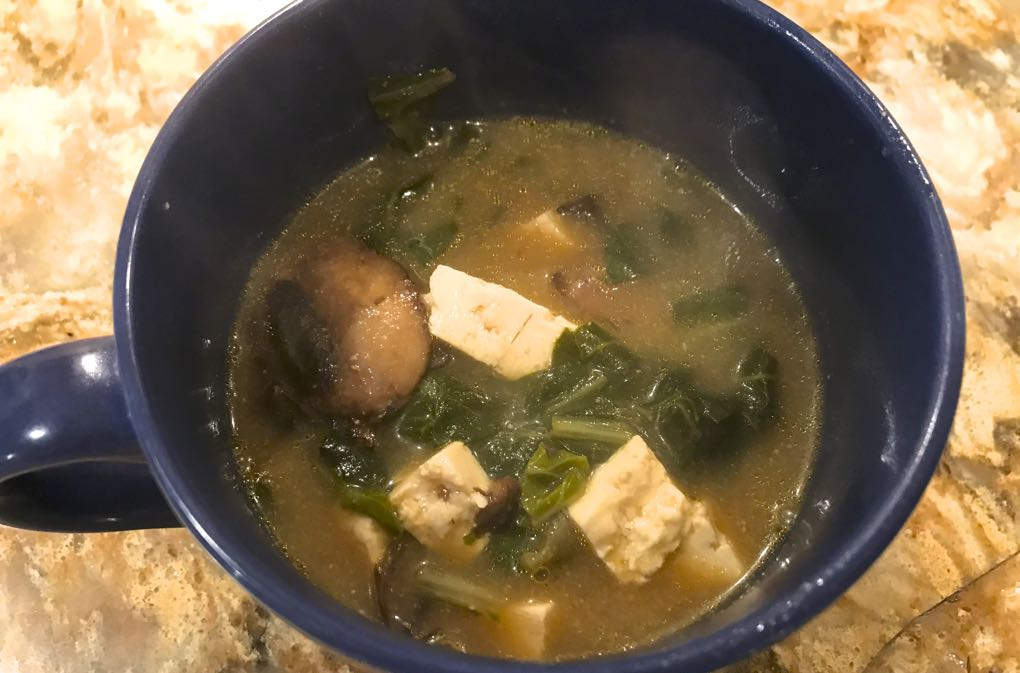 Photo of Miso Soup in blue soup cup, one of the best soups for cold and flu
