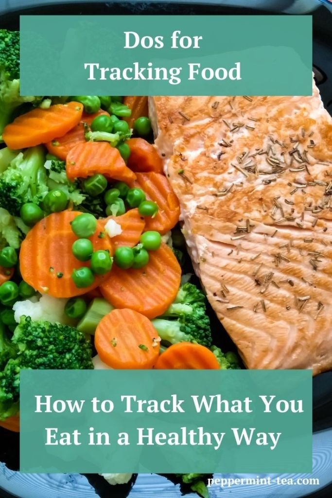 Photo of grilled salmon and broccoli and carrots as an example of tracking food.