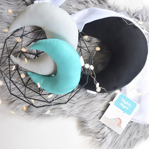 Standard Black, Medium Light Grey, Small Mint Moon Cushions on faux fur grey rug