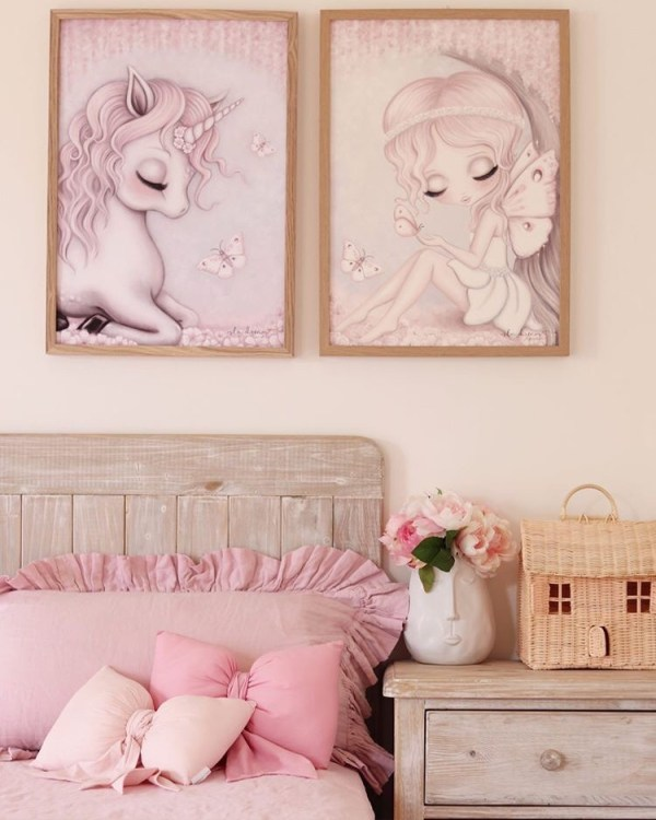 Girls Bed with Pink Ruffle Linen, Rattan Dollhouse on bedside drawers, Unicorn and Fairy Print on Wall and Baby Pink and Rose Pink Bow Cushions on bed