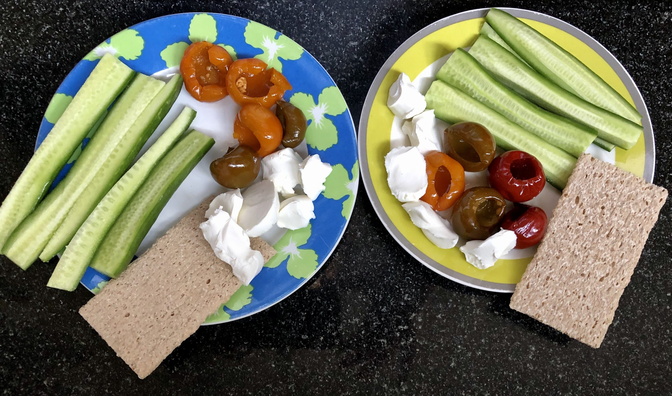 Mediterranean diet breakfast: marinated mini peppers, cucumbers, goat cheese and crackers