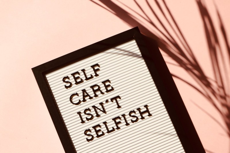 Self Care Isn't Selfish sign to help you Survive Stay-at-Home by Challenging Yourself