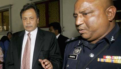 NFCorp chief claims trial to four charges