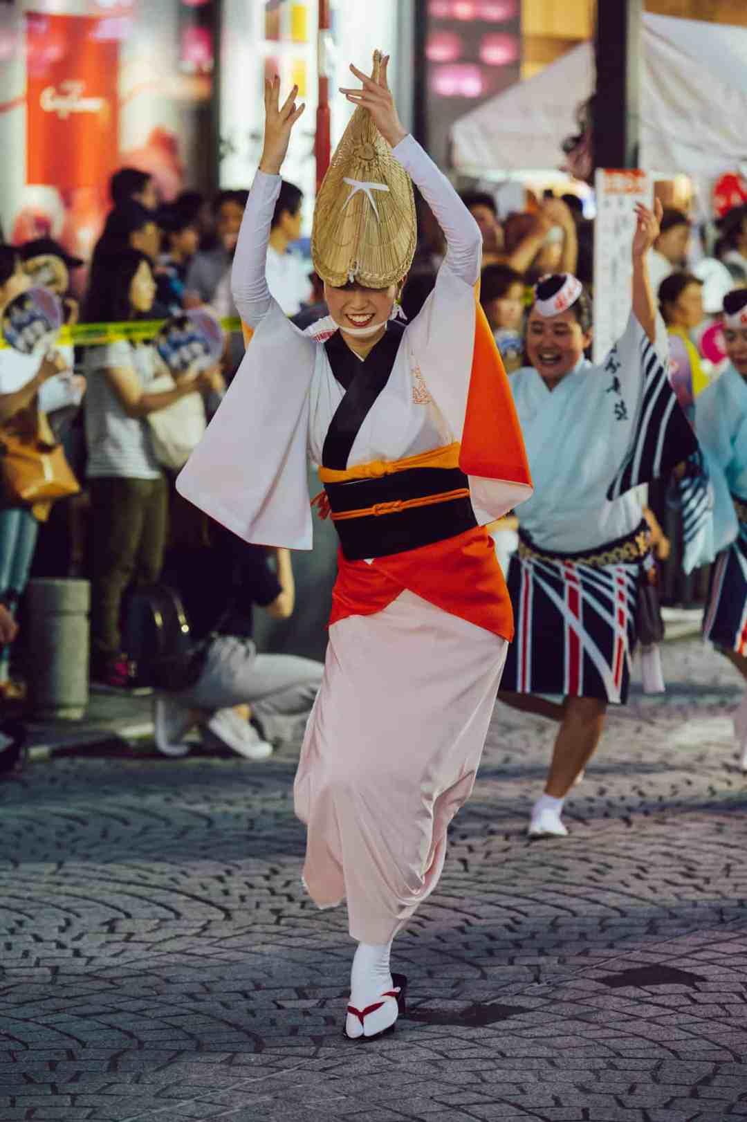 A Japanese woman dances in an Awa Odori festival in Tokyo, Japan.