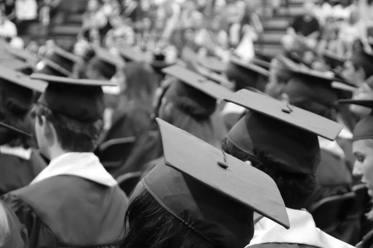 Black & White picture of college students at a graduation ceremony
