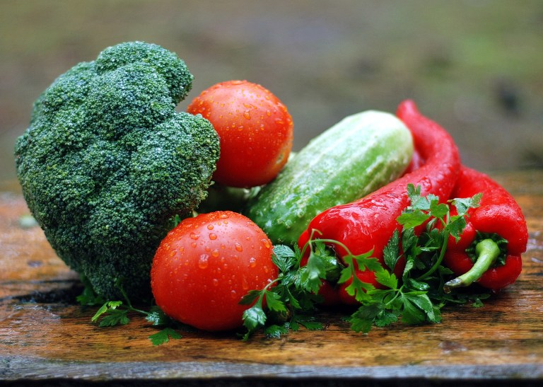 A bundle of vegetables on a table.