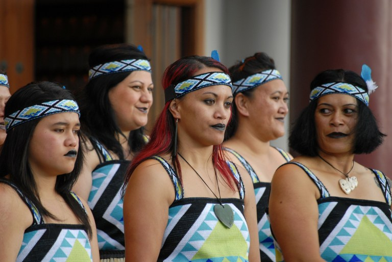 A group of Maori women standing in traditional dress