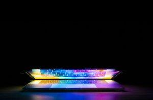 A half closed laptop in the dark