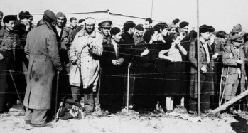 16 Feb 1939, Le Perthus, France --- Le Perthus, France: Concentration Camp A Haven---The thought of concentration camps, Nazi style, is one to send a chill of dread running up and down our spines. To these Spanish refugees, fleeing before Franco's victorious insurgent armies. The concentration camp at Le Perthus, just across the Spanish border is a haven of security, offering food, shelter and safety. Care of these refugees present a major problem to the French as the exodus across the border runs into the hundreds of thousands. --- Image by © Bettmann/CORBIS