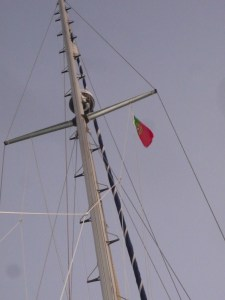 The Portuguese courtesy flag is up - uncontrollable excitement for one member of the crew!