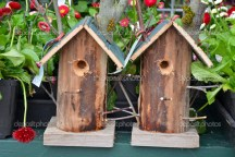 Two homemade wooden birdhouses for sale