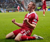 Aberdeen's Adam Rooney scored the goal as his side beat Dumbarton in the Scottish Cup semi final