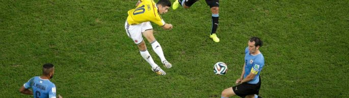 Colombia's Rodriguez scores a goal past Uruguay's Godin Pereira and Rios during their 2014 World Cup round of 16 game at the Maracana stadium in Rio de Janeiro